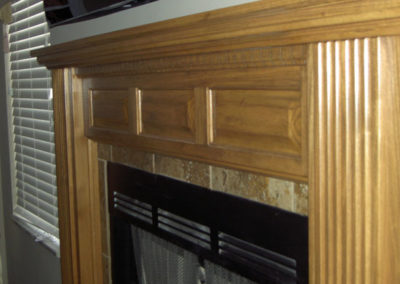 Custom mantle with fluted pillars and a raised panel breast board