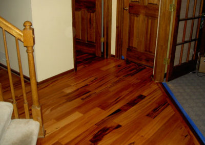 Floor laying, sanding, and finishing in entry and half-bath
