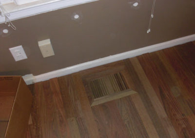 Flush wooden heat register of the same species as the hardwood flooring
