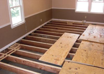 "Installation of ¾"" plywood sub-floor"