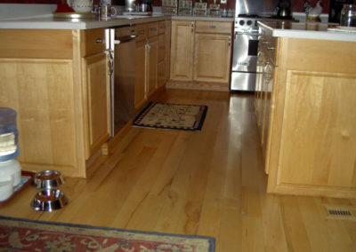 Maple hardwood flooring--site-finished--alongside maple kitchen cabinets
